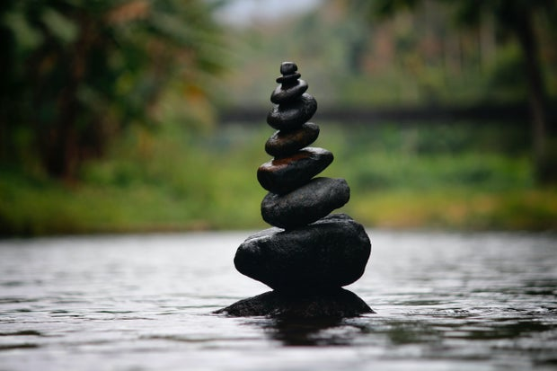 black rocks stacked in water