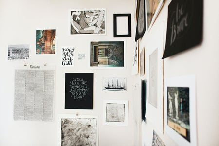 prints and art hanging on wall
