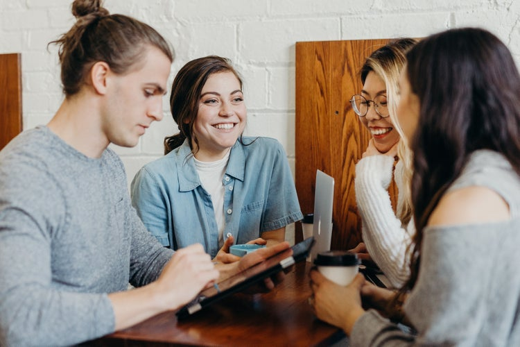 group of people talking at a coffee shop