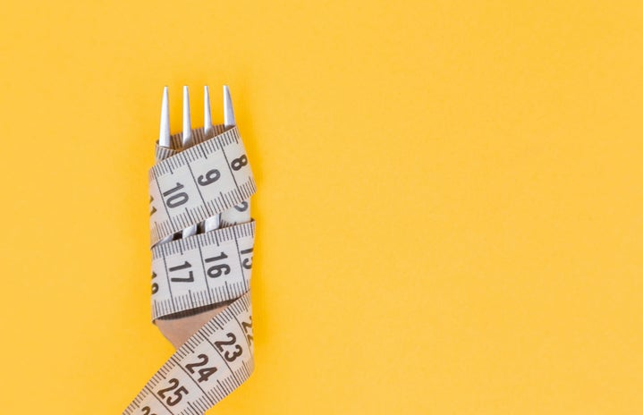 Fork with tape measure wrapped around it