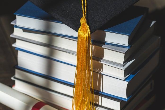 Grad cap and books