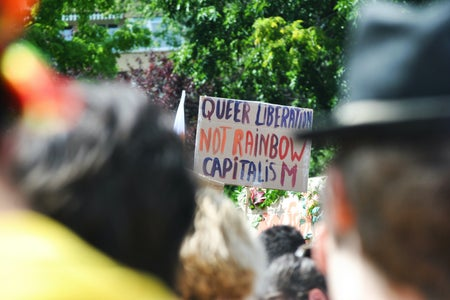 queer liberation not rainbow capitalism sign