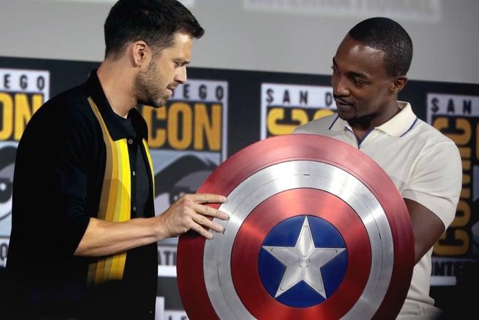 sebastian stan and anthony mackie holding captain america\'s shield