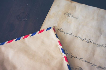 a paper envelope on top of a letter