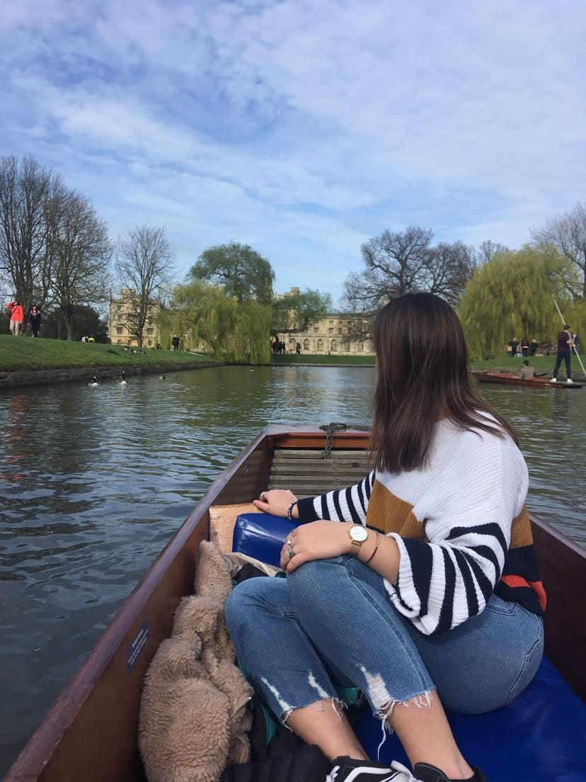 girl in a boat on the river in cambridge