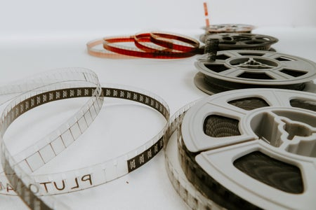 Four film reels on a white background