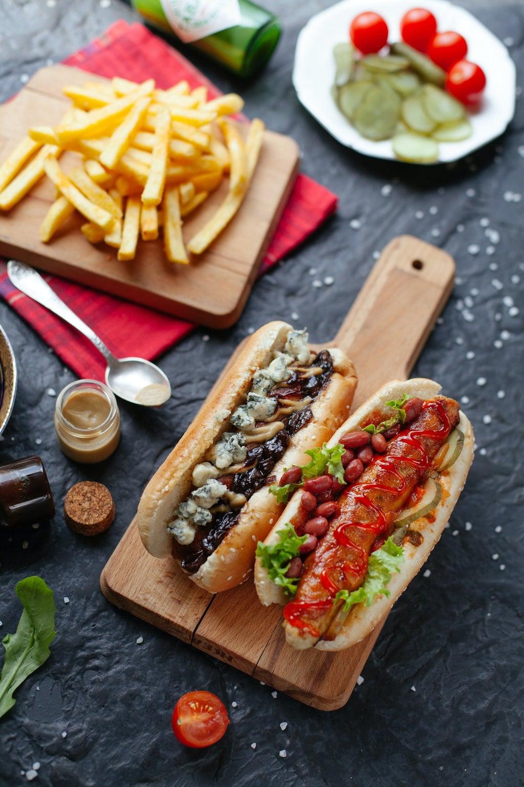 fancy hotdogs on a cutting board