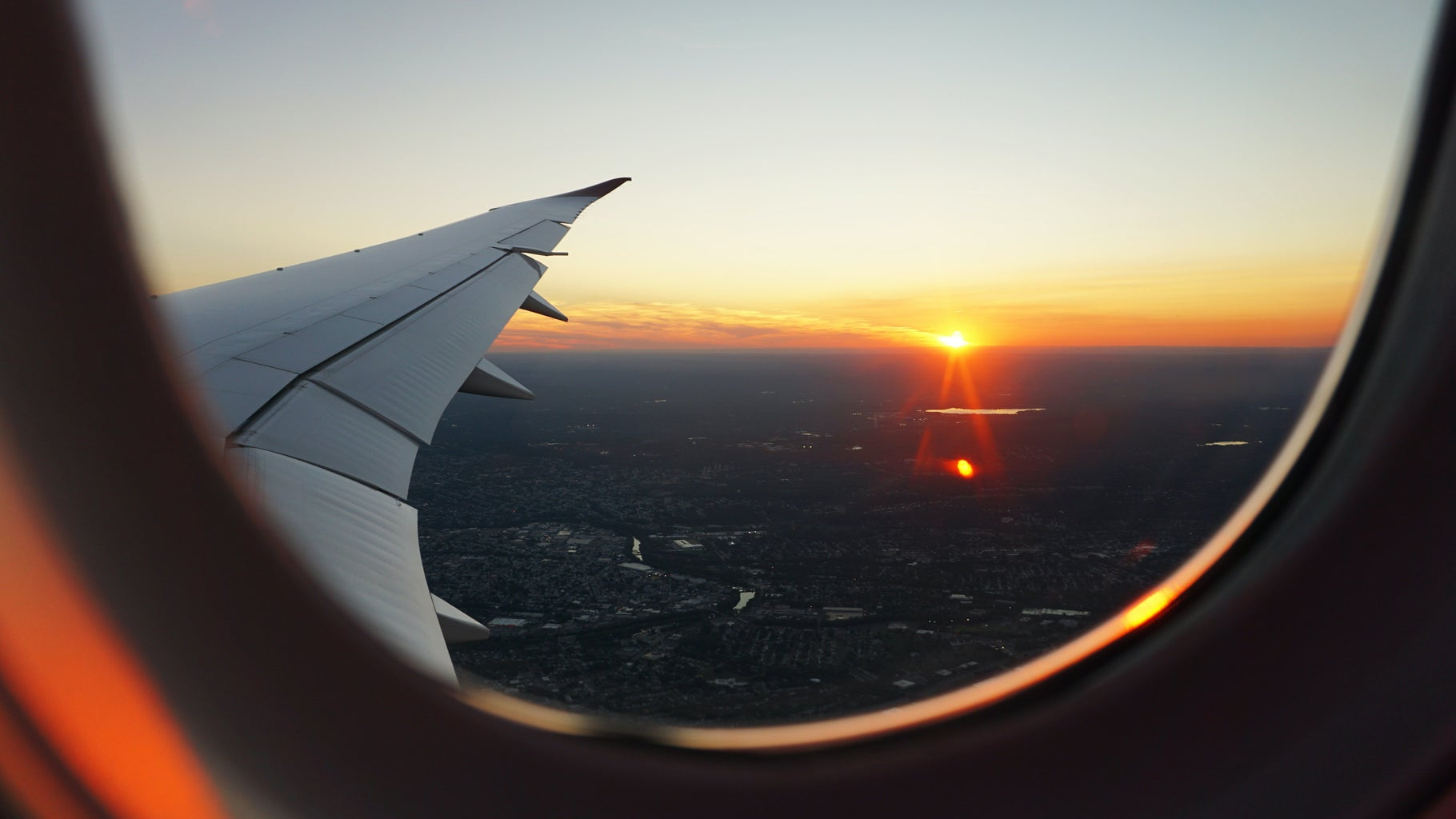 airplanes window view of sky during golden hour