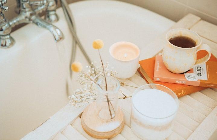 Coffee cup near bathtub