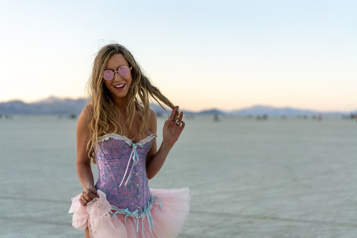 Woman in purple corset with pink tutu and pink glasses