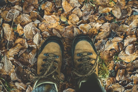 hiking boots on leaves