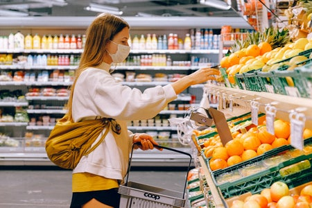 masked woman in a grocery store