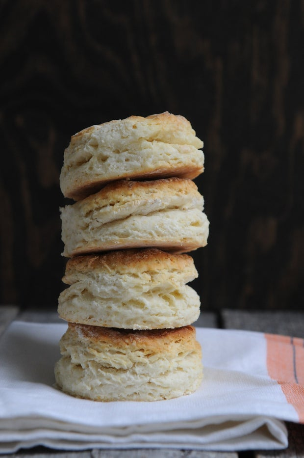 stack of four biscuits on cloth on table
