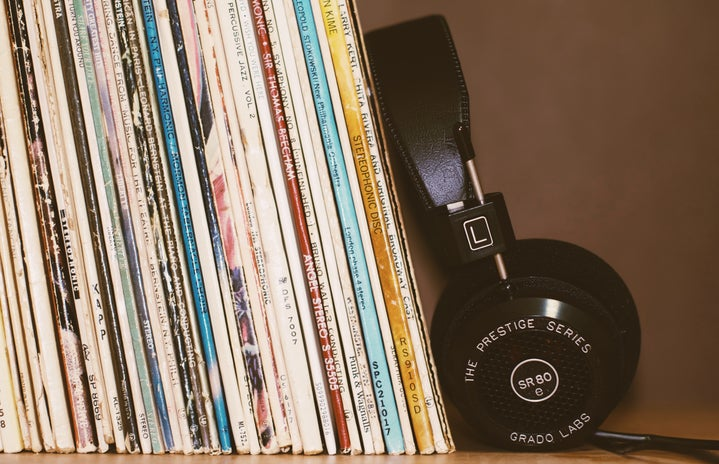 Headphones leaning against records