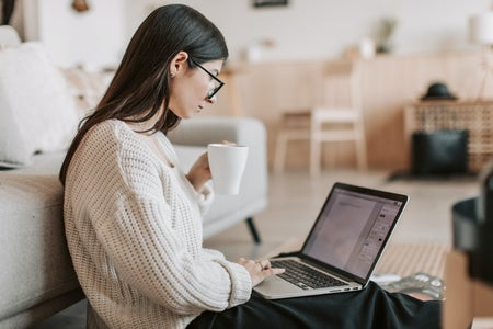 women with mug and laptop