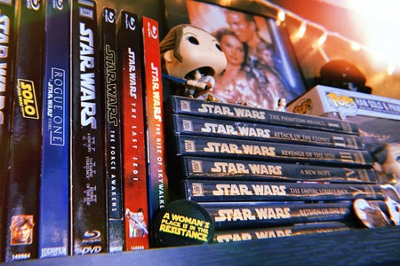 Collection of Star Wars DVDs and memorabilia