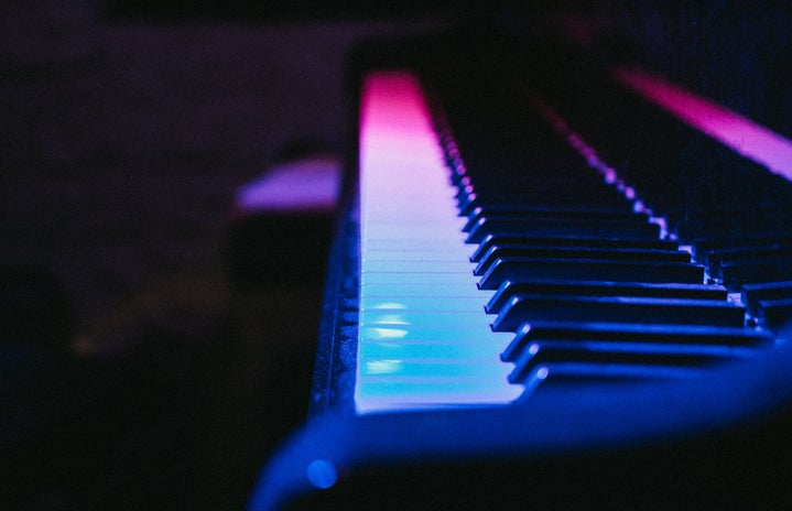 Piano with blue and pink lighting