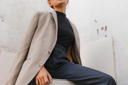 woman wearing suit and button up fall fashion