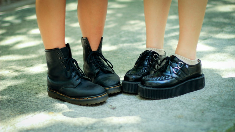 two pairs of platform black boots