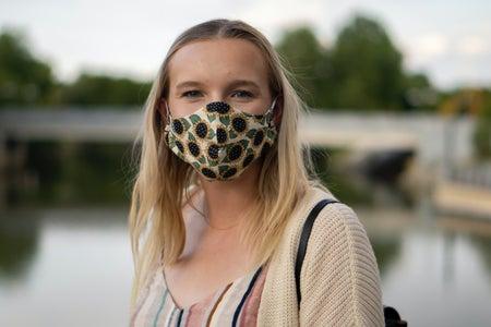 blonde girl wearing a mask