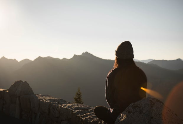 woman meditating on mountain