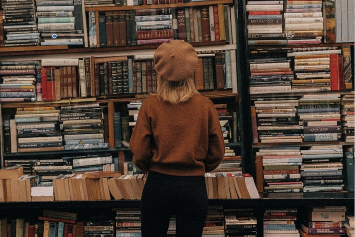 Sarah in front of books