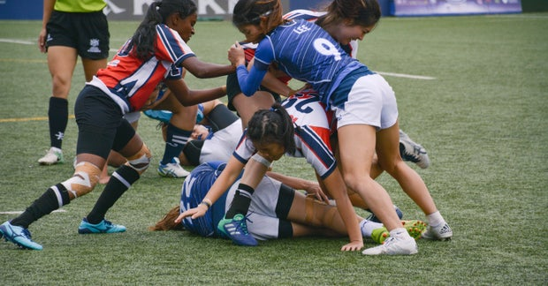 women's rugby team tackle