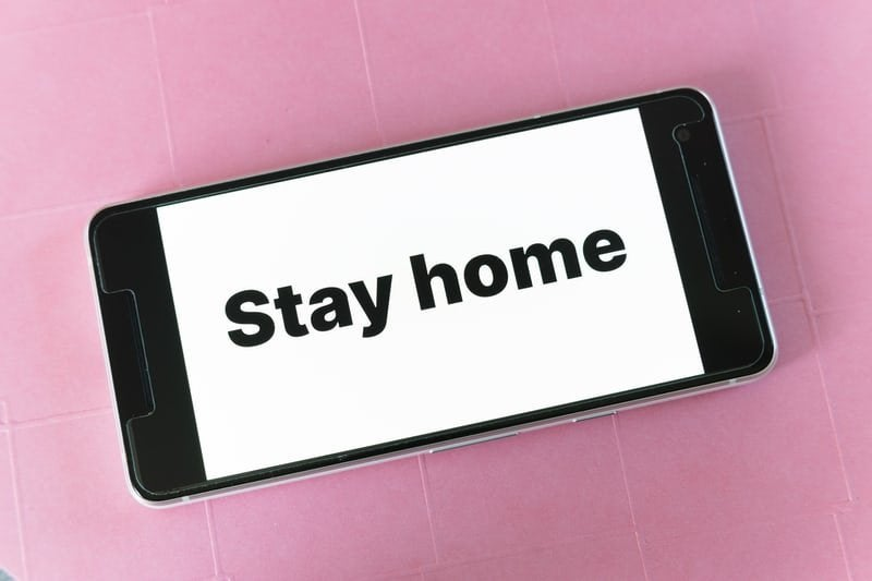 a phone that says stay home