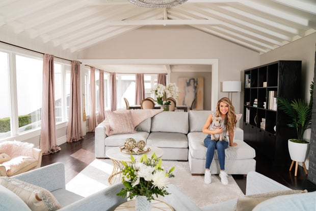 Chrishell Strause in house with dog