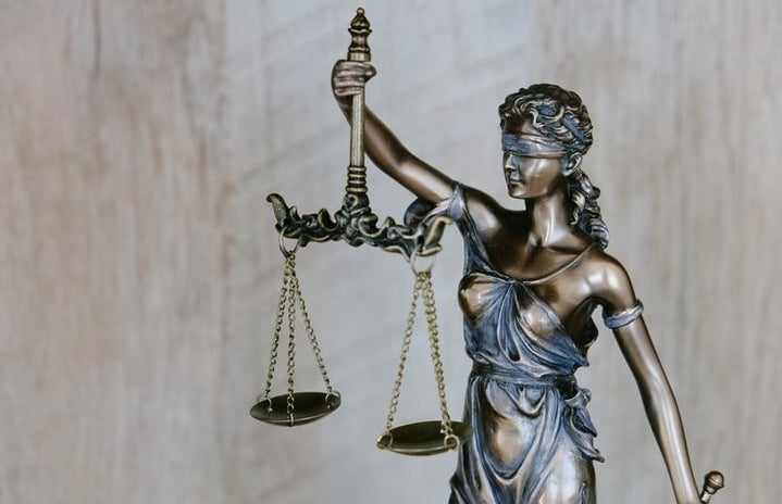 Woman holding justice weights