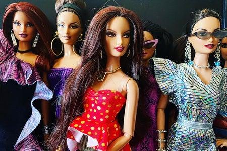 Four fabulously-dressed fashion dolls.