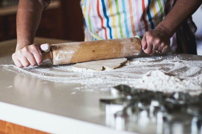 person holding a rolling pin