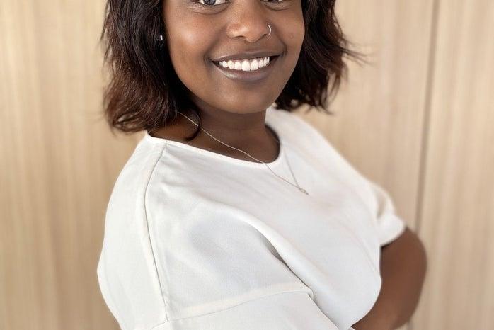 Tess Yieke side profile smiling in white top