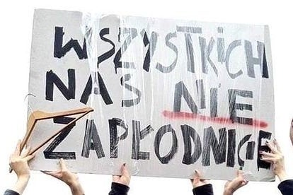 Picture of a sign designed by Dominika Komender used at a protest in Poland in 2016 which reads (in translation): 'You can't knock us all up'