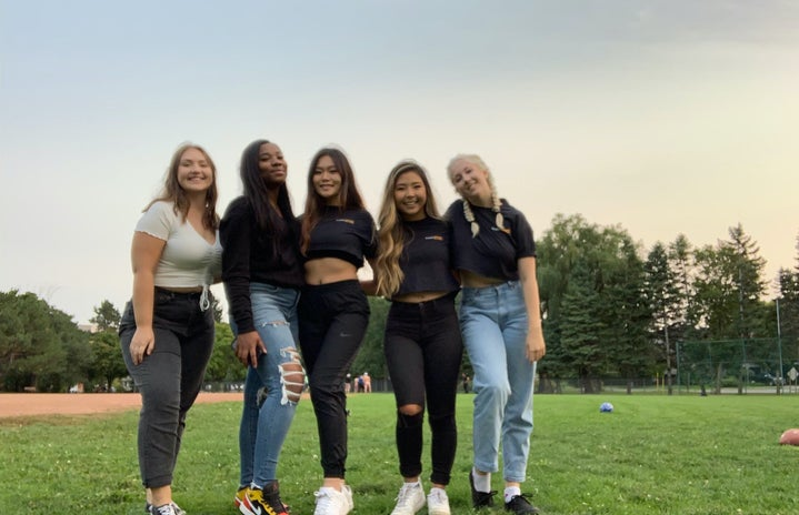 group of girl friends in a field