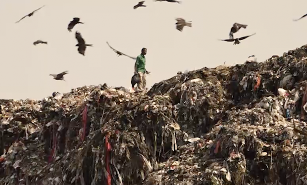 COVID-related waste ends up at the Ghazipur Landfill in New Delhi despite laws requiring the separation of bio-medical waste
