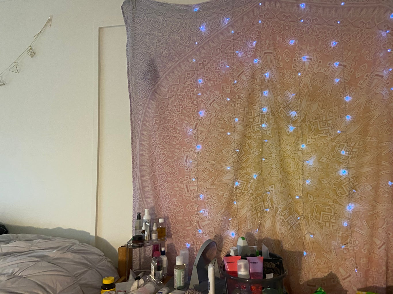 Tapestry and fairy lights in college dorm