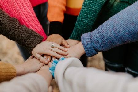 Girls hands together