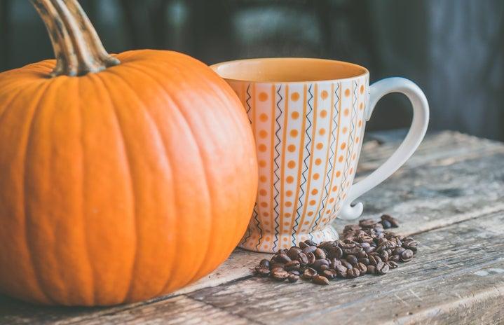 pumpkin and mug with coffee grounds