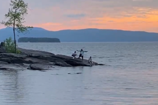 Picture of 99 Neighbors filming a music video on Lake Champlain in Burlington, Vermont.
