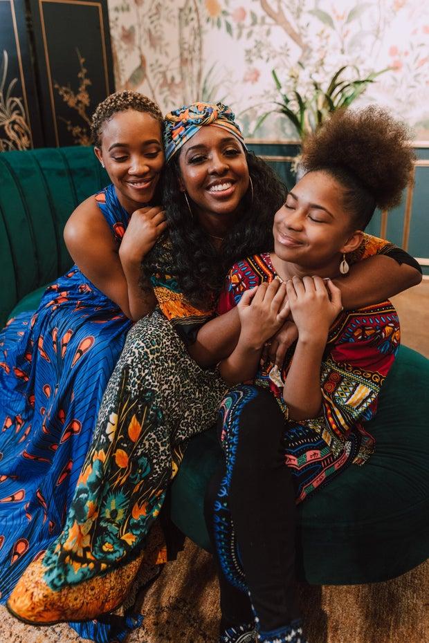 black women smiling and hugging