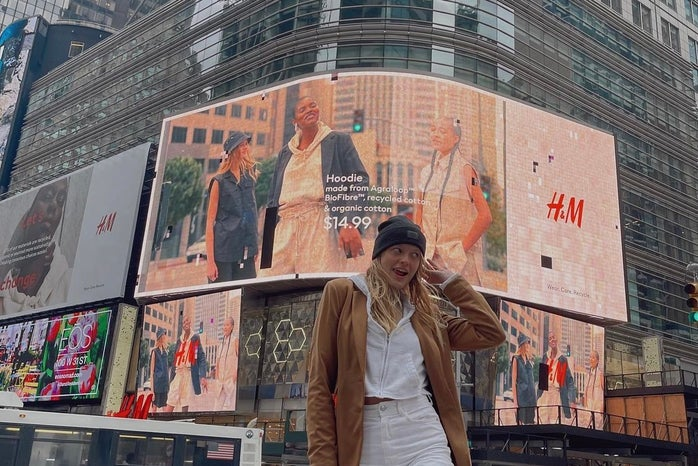 Girl in front of big screen in New York City