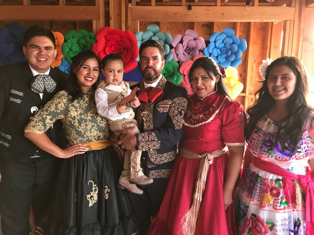 Family dressed in charro style clothing