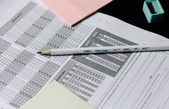 gray and white click pen on scantron test sheet