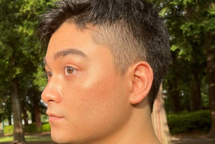 Men in makeup, glowy side profile photo
