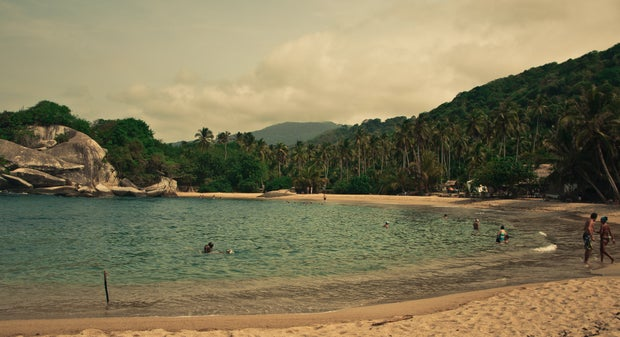 people swimming on sea during daytime photo in Santa Marta, Colombia
