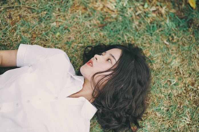 Woman lies in the grass