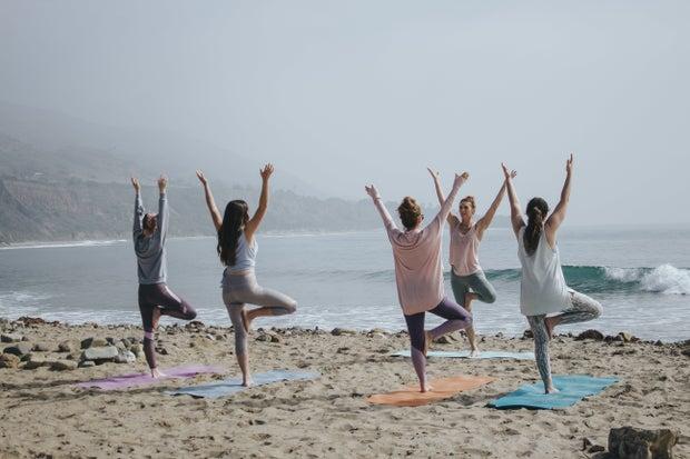 Five women doing yoga