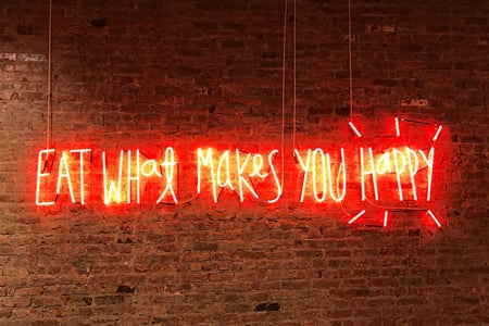 eat what makes you happy neon sign