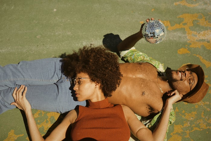 man and woman laying down